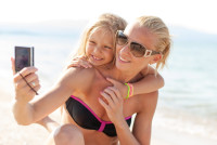 Mother and daughter selfie photographed at the beach