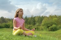 Girl meditating in nature