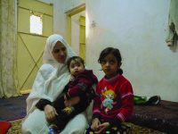 Sabeen with her two youngest children. Sabeen and her family fled Syria two years ago after their home came under attack.