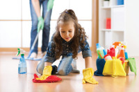 Cute child little girl with her mother cleanse a floor in nursery at home