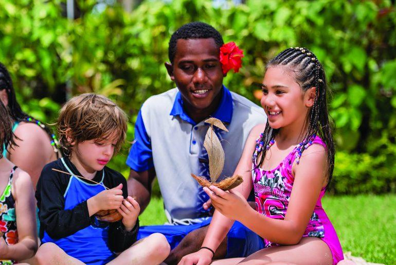Fijian people. Outdoor activities. Kids on holiday at Radisson Blu Resort