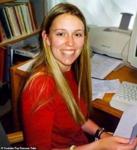 Jacinda sitting in front of desk