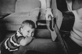 Baby listening to guitar