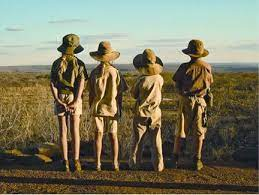 Four kids dressed in Safari gear playing outside